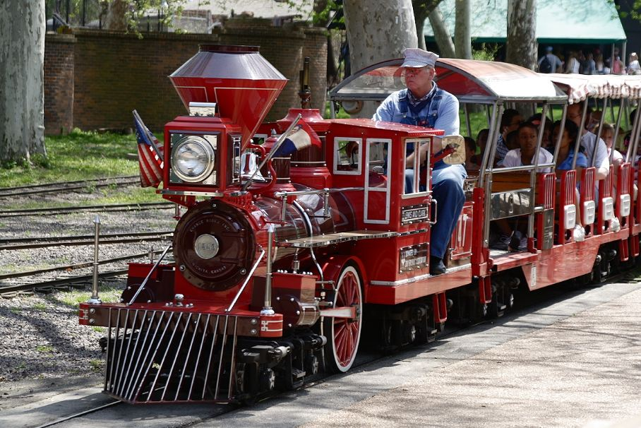 A 'Grand Scale' red locomotive model being used as an amusement ride.