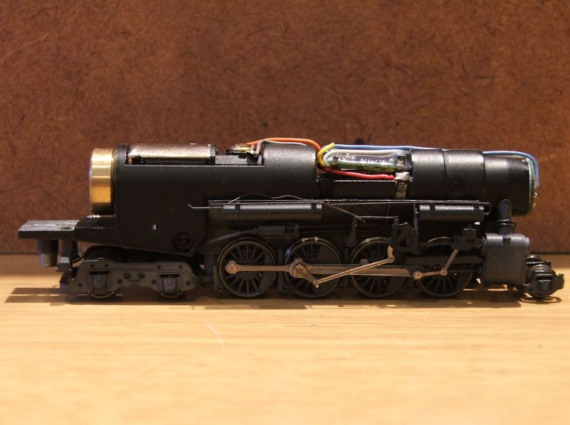 A DCC decoder unit installed within a steam model locomotive unit.